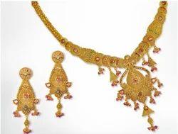 Fourteen K Plain And Studded Gold