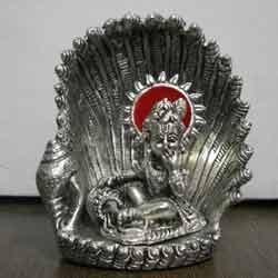 white metal krishna idol