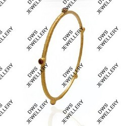 Thin Gold Bangles With Black Metal Work