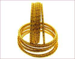 Set Of 12 Gold Bangles