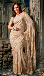 Cream Faux Georgette Designer Saree With Pearl And Stone Work