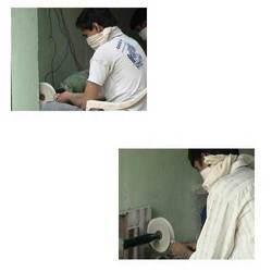 Workman working on Polisher