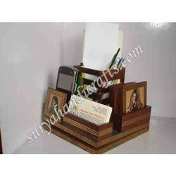 Teak Wood Pen And Mobile Stand With Lecker On It