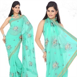 Enchanting Turquoise Faux Georgette Saree With Blouse
