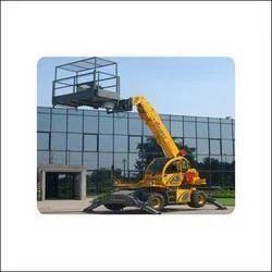 man lifts hydraulic crane
