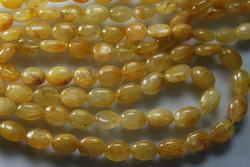 Golden Rutile Smooth Oval Nuggetes