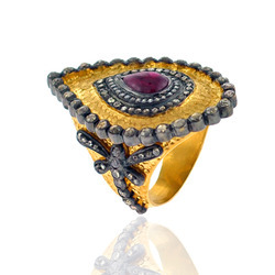 Drop shaped pave diamond ring with ruby