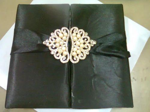 diamond broach designer wedding cards