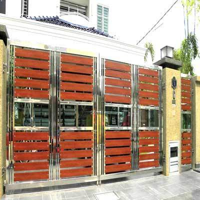 Designer wooden main gate gate grilles fences railings g s metal craft in woraiyur for Wooden main gate design for home