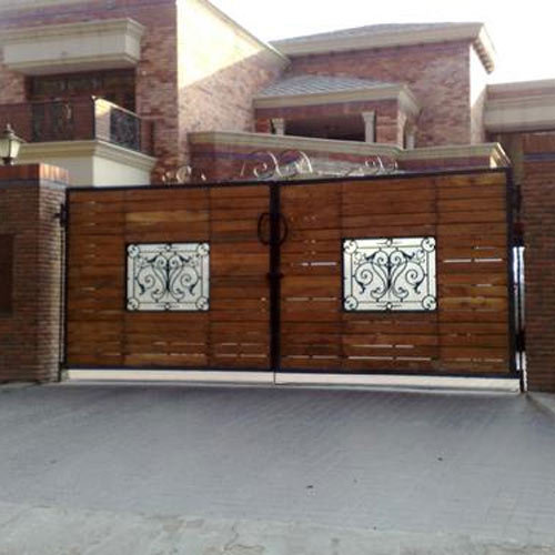 Designer iron wooden gate shiv steel plywood retailer in industrial area panchkula id for Wooden main gate design for home