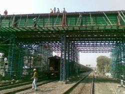 Road Over Bridge on Running Railway Line