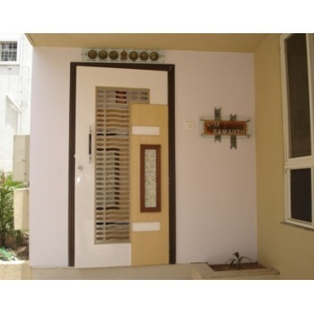 Flat entrance decoration main door design foyer design for Main door design for flat