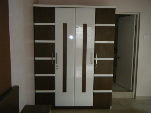 Designer wardrobes designer wardrobes shreeji modular for Door design new model 2017